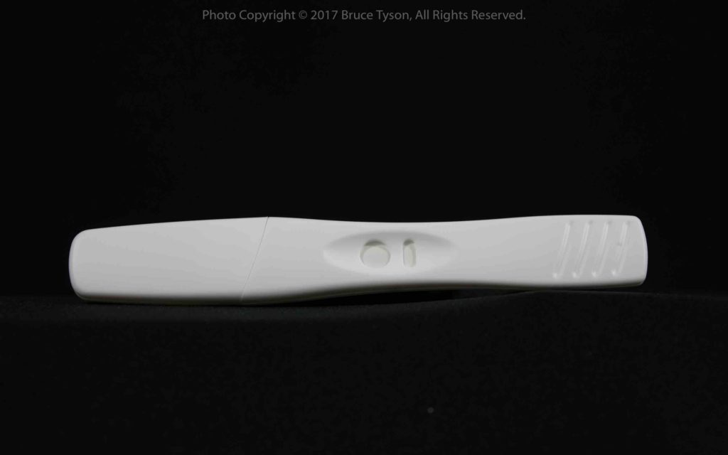 Accu Clear pregnancy test -- Test stick with cap in place